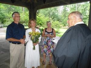 Rev. Emory Gilbert officiates